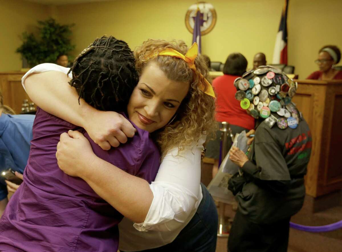 Shere Dore, center, hugs another supporter after the Prairie View City Council decided to keep the name Sandra Bland Parkway on Tuesday.