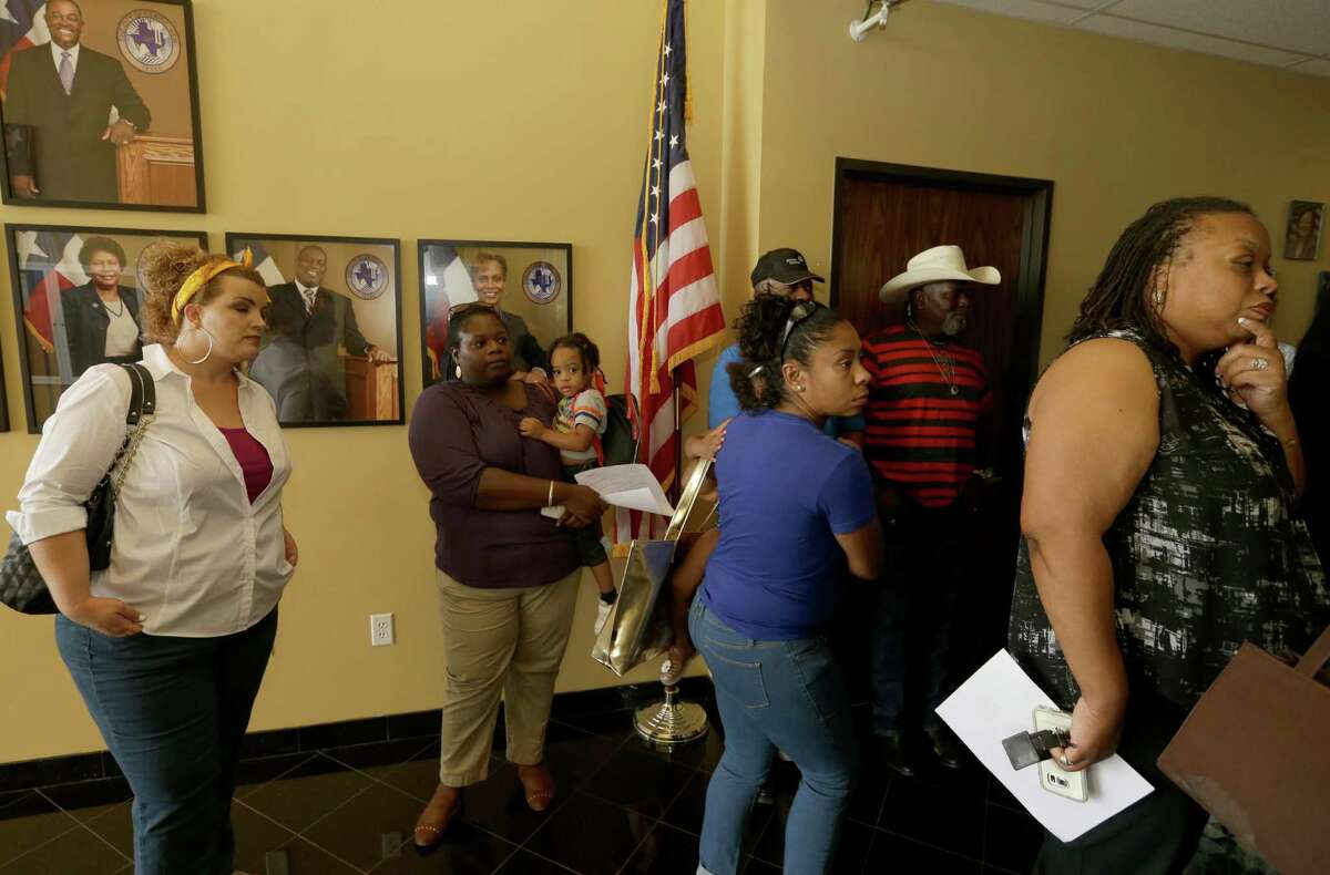An overflow crowd waits in the hall during the Prairie View City Council meeting on Tuesday.