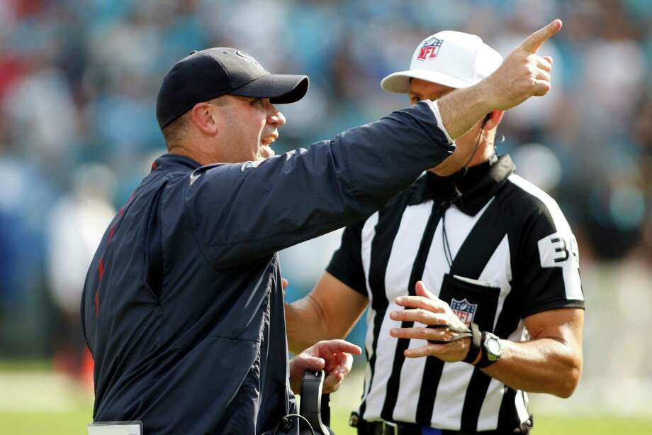 Houston Texans head coach Bill O'Brien argues a call with referee Clete Blakeman (34) on the sidelines against the Carolina Panthers during the second half of an NFL football game in Charlotte, N.C., Sunday, Sept. 20, 2015. The Panthers won 24-17. Photo: Bob Leverone /Associated Press / FR170480 AP