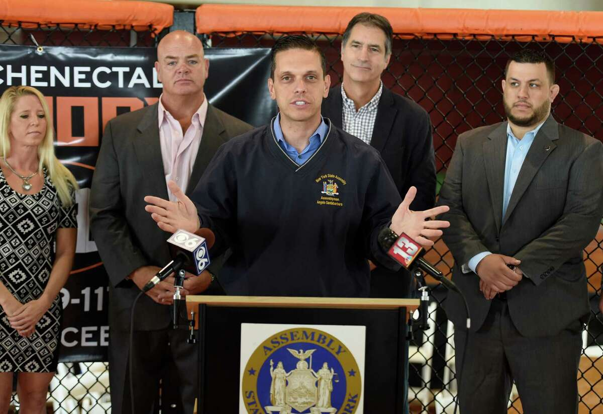 Assemblyman Angelo Santabarbara stands in an octagon ring to promote the upcoming Amateur MMA fight Tuesday Sept. 22, 2015 at the Schenectady Armory in Schenectady, N.Y. The fight card will take place Saturday night at the Armory. (Skip Dickstein/Times Union)