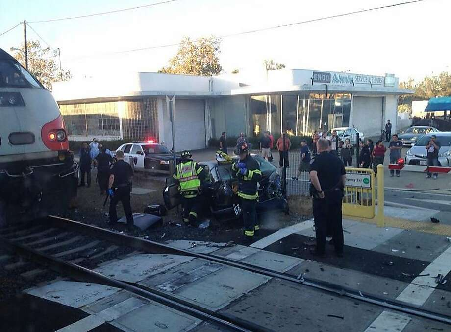 A car was struck by a Caltrain in San Mateo on the evening of Sept. 22. The driver suffered minor injuries and train service was briefly halted before the wreck was cleared. Photo: Courtesy, Matt Stewart