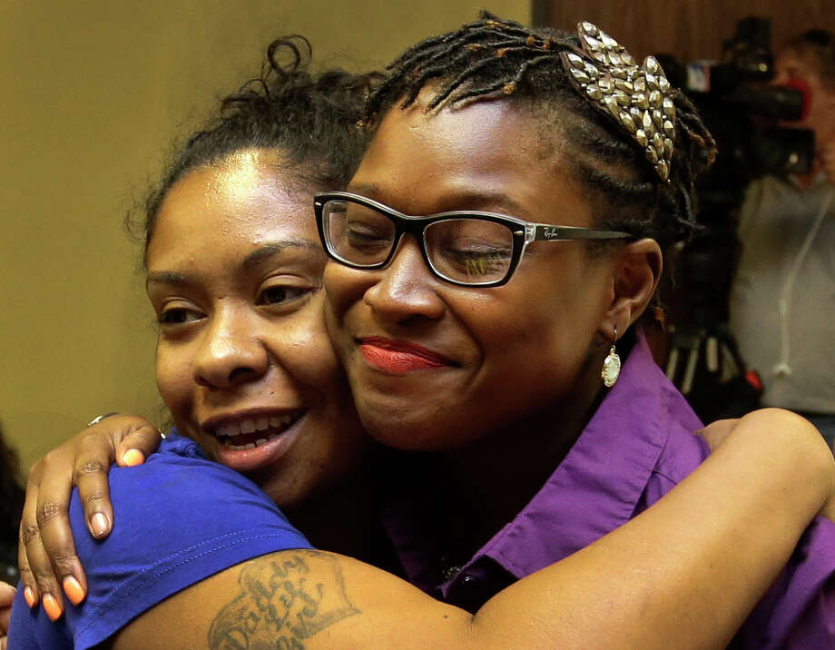 Alexandria De La Cruz, left, and LaToya Smith celebrated after the Prairie View City Council decided not to reverse an earlier decision to rename part of University Drive to Sandra Bland Parkway.  Photo: Melissa Phillip, Staff / © 2015 Houston Chronicle