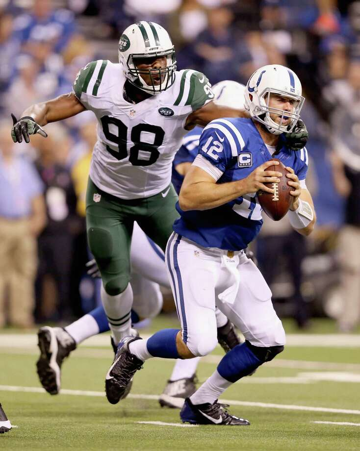 INDIANAPOLIS, IN - SEPTEMBER 21:  Andrew Luck #12  of the Indianapolis Colts is sacked by Quinton Coples #98 during the game against the New York Jets  at Lucas Oil Stadium on September 21, 2015 in Indianapolis, Indiana.  (Photo by Andy Lyons/Getty Images) ORG XMIT: 567081323 Photo: Andy Lyons / 2015 Getty Images