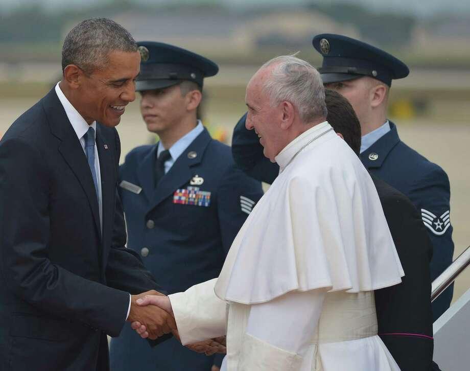 US President Barack Obama (L) greets Pope Francis (R) upon his arrival  September 22, 2015 at Andrews Air Force Base in Maryland. AFP PHOTO/MANDEL NGANMANDEL NGAN/AFP/Getty Images Photo: MANDEL NGAN, Staff / AFP / Getty Images / AFP