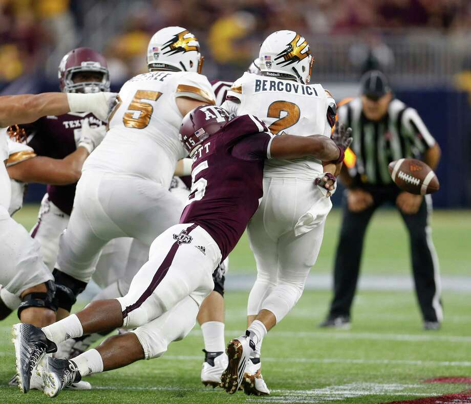 Texas A&M is hoping the ongoing maturation of young players like Myles Garrett, here sacking Arizona State quarterback Mike Bercovici, will be the difference in continuing to play well once SEC play begins on Saturday. Photo: Karen Warren, Staff / © 2015 Houston Chronicle