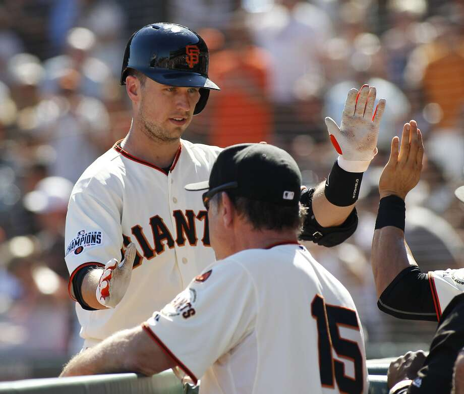 San Francisco Giants' Buster Posey is greeted in the dugout after hitting a three-run homer against the Arizona Diamondbacks during the sixth inning of a baseball game, Sunday, Sept. 20, 2015, in San Francisco. (AP Photo/George Nikitin) Photo: George Nikitin, Associated Press