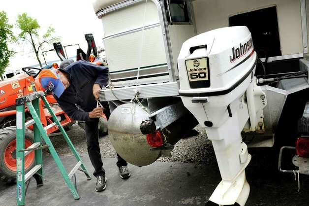 Employee John Best makes the final preparations before a pontoon boat is shrink wrapped for winter storage on Tuesday, Sept. 22, 2015, at South Shore Marina in Malta, N.Y. (Cindy Schultz / Times Union) Photo: Cindy Schultz / 00033459A