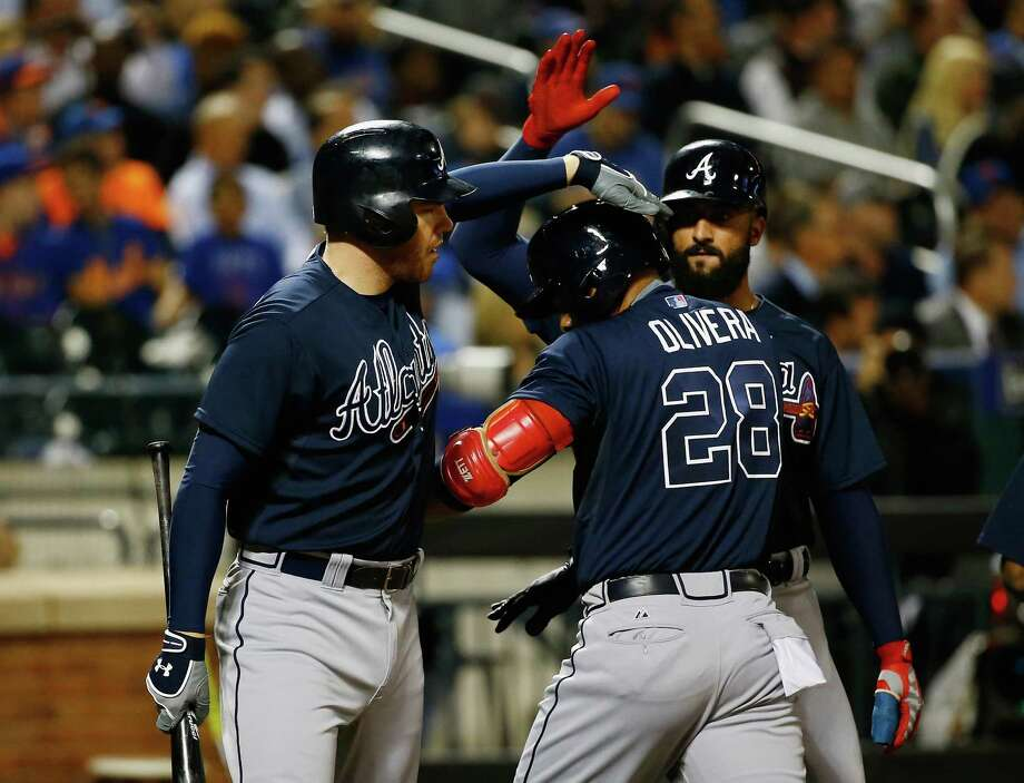 NEW YORK, NY - SEPTEMBER 22:  Joey Terdoslavich #28 of the Atlanta Braves celebrates his home run in the fifth inning against Logan Verrett #35 of the New York Mets with his teamates during their game at Citi Field on September 22, 2015 in New York City.  (Photo by Al Bello/Getty Images) ORG XMIT: 538595321 Photo: Al Bello / 2015 Getty Images