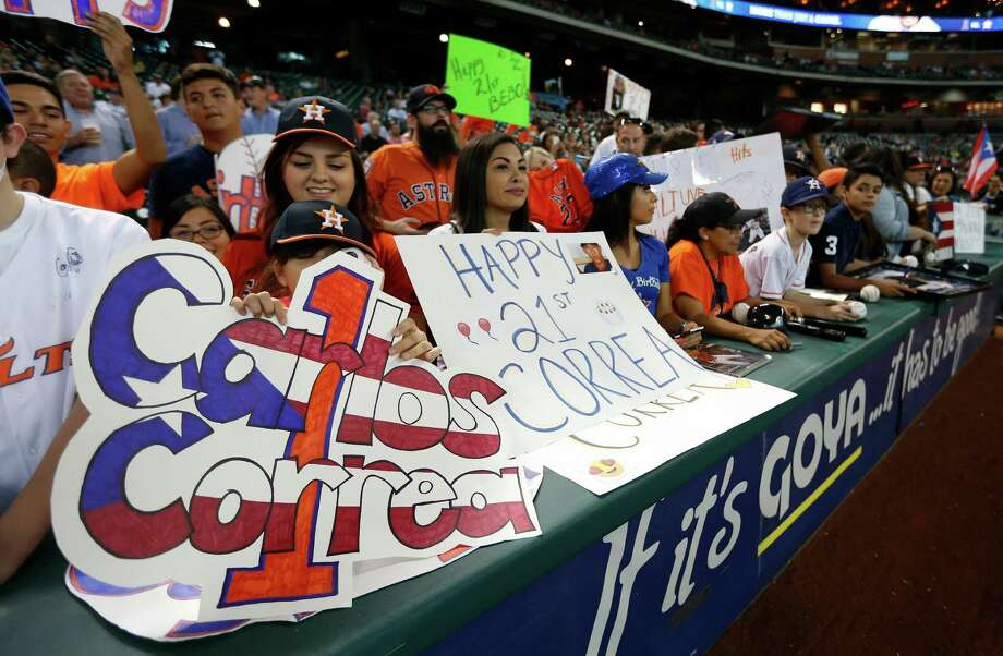 The fans were ready to celebrate Carlos Correa's 21st birthday with the rookie shortstop. Photo: Karen Warren, Staff / © 2015 Houston Chronicle