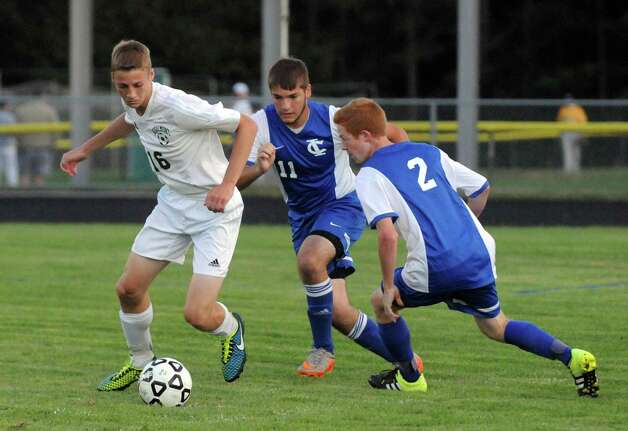 Schalmont's Ryan Older and Ichabod Crane's Bryant Halpin, center, and George Cox battle for the ball during their boy's high school soccer game on Tuesday Sept. 22, 2015 in Schenectady, N.Y.  (Michael P. Farrell/Times Union) Photo: Michael P. Farrell / 00033429A