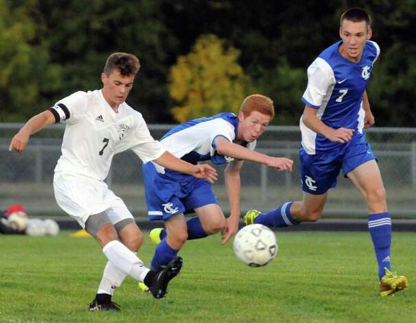 Schalmont's RJ Hayden and Ichabod Crane's George Cox, center, and Shane Wenz battle for the ball during their boy's high school soccer game on Tuesday Sept. 22, 2015 in Schenectady, N.Y.  (Michael P. Farrell/Times Union) Photo: Michael P. Farrell / 00033429A