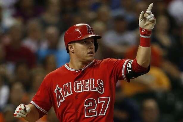 Los Angeles Angels center fielder Mike Trout celebrates his two-run, in the park home run during the first inning of an MLB game at Minute Maid Park on Tuesday, Sept. 22, 2015. ( Karen Warren / Houston Chronicle )