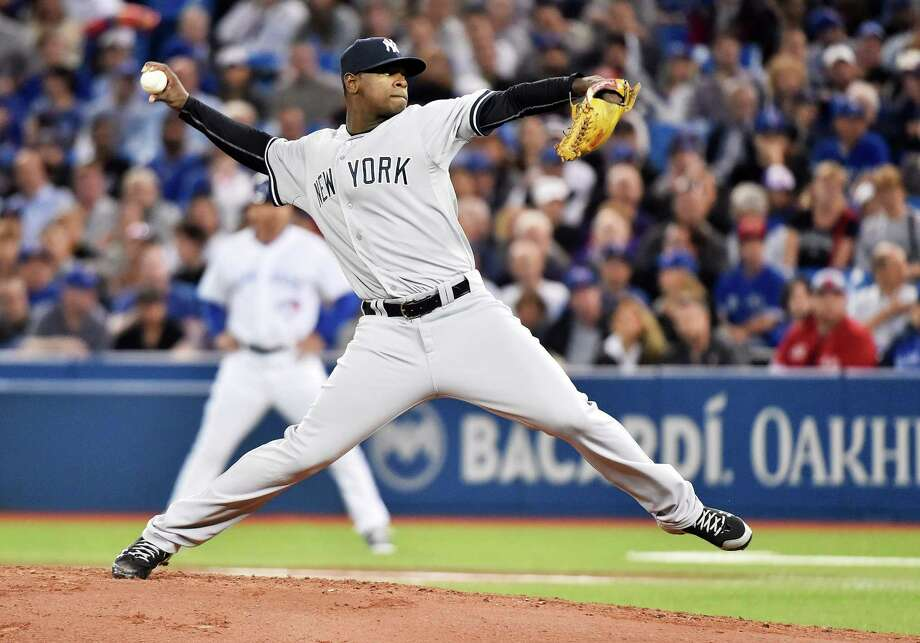 New York Yankees' starting pitcher Luis Severino works against the Toronto Blue Jays during the first inning of a baseball game Tuesday, Sept. 22, 2015, in Toronto. (Nathan Denette/The Canadian Press via AP) MANDATORY CREDIT ORG XMIT: NSD103 Photo: Nathan Denette / The Canadian Press