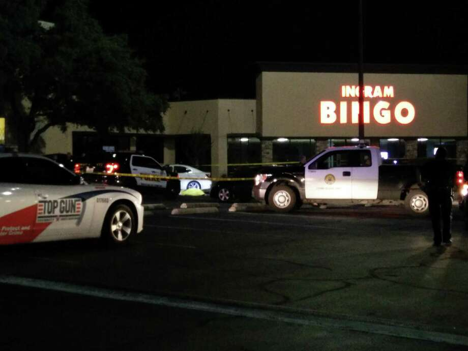 The scene at a strip mall after a security guard shot and killed a suspected car burglar who police say tried to run him over at a strip mall on Loop 410 near Ingram Road on the night of Tuesday, Sept. 22, 2015. Photo: Jacob Beltran / Jacob Beltran