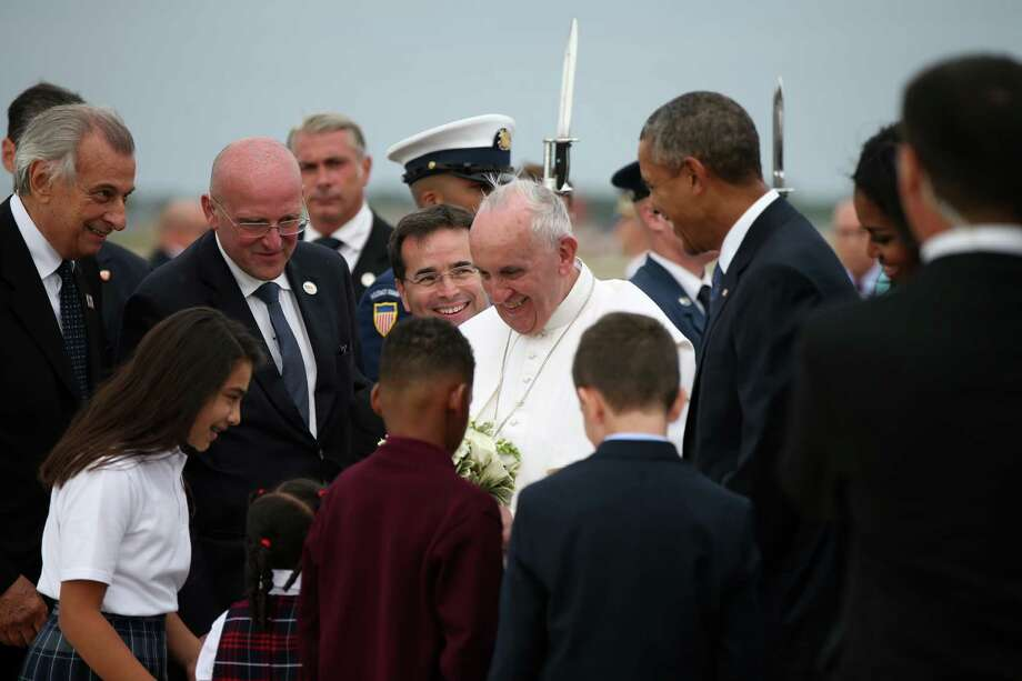 Pope Francis, accompanied by President Barack Obama, and others,  is greeted upon his arrival at Andrews Air Force Base, Md., Tuesday, Sept. 22, 2015. Photo: Andrew Harnik / Associated Press / Associated Press
