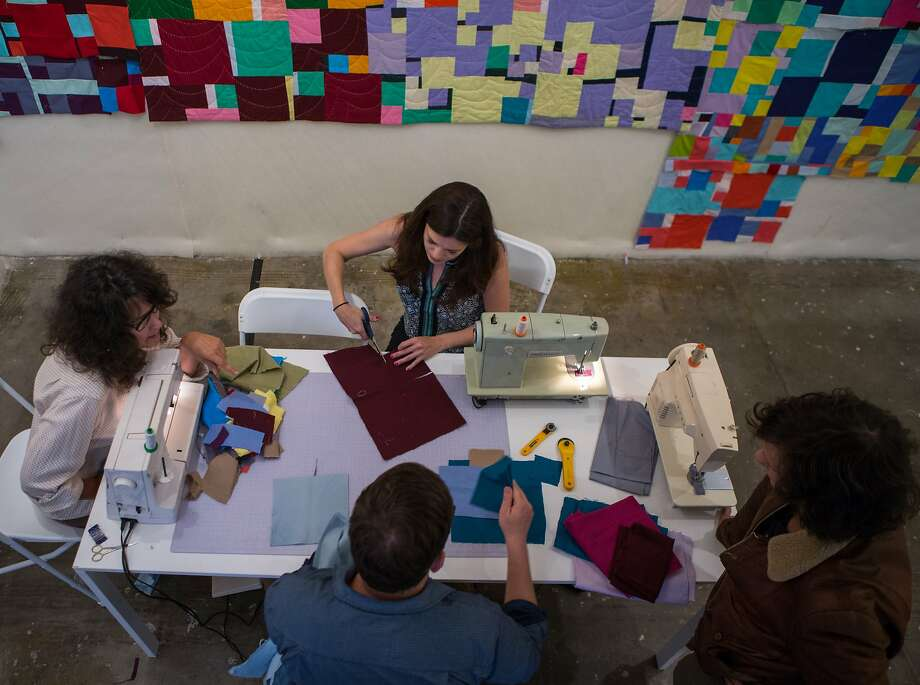 Sherri Lynn Wood, clockwise from left, leads a quilting clinics with Tamara Ribas, Jon Fellman and Christian Davies at Adobe Books Backroom Gallery in San Francisco. Photo: Nathaniel Y. Downes, The Chronicle