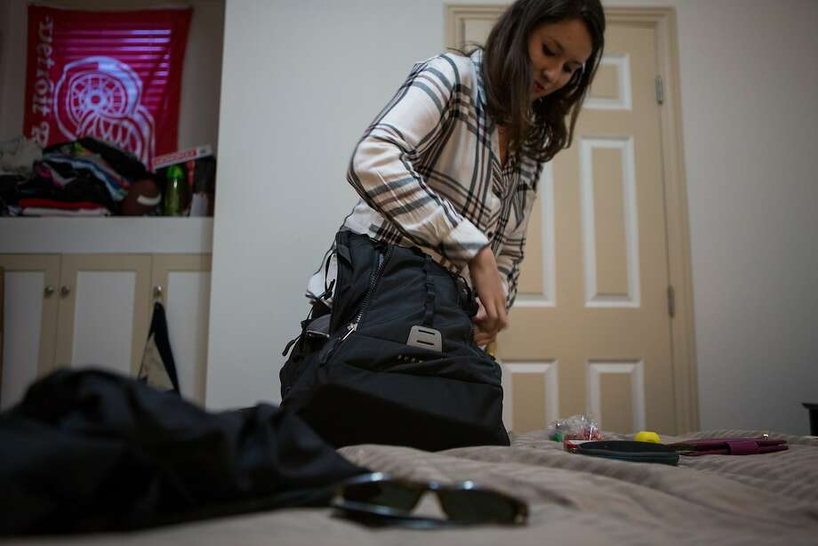 Alexandra Revelli, an employee with Expensify, packs for her fourth trip with the company on Sept. 22, 2015, in San Francisco. Photo: Nathaniel Y. Downes, The Chronicle