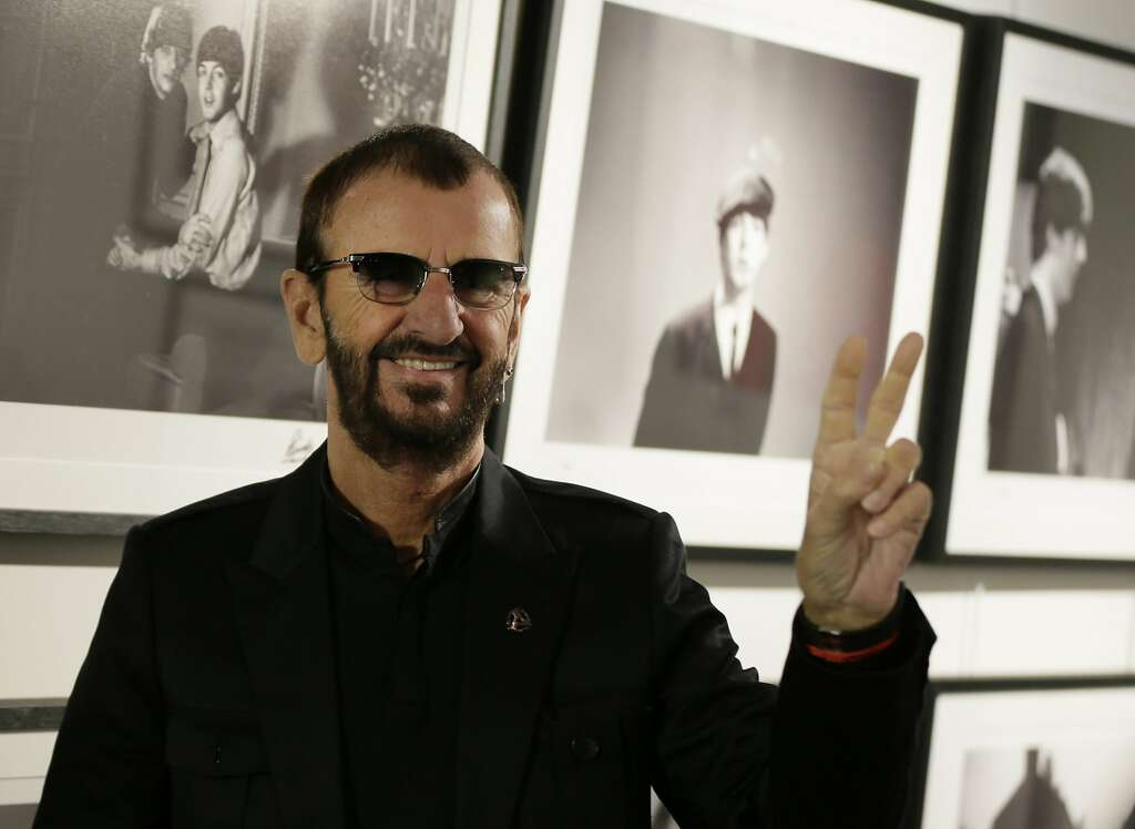 Pop icon and former Beatle Ringo Starr poses for the media in front of some of his photographs during a photocall as he launches a book called 'Photograph' in London, Wednesday, Sept. 9, 2015. The book contains photographs by Starr from his childhood, the Beatles and beyond. (AP Photo/Alastair Grant) Photo: Alastair Grant, Associated Press