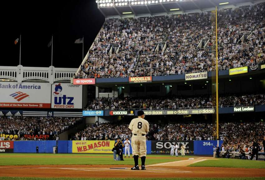 File- This Sept. 21, 2008, file photo shows former New York Yankees player Yogi Berra at home plate at Yankee Stadium in New York before the Yankees play the Baltimore Orioles in the final regular season baseball game at the stadium. Berra, the Yankees Hall of Fame catcher has died. He was 90.