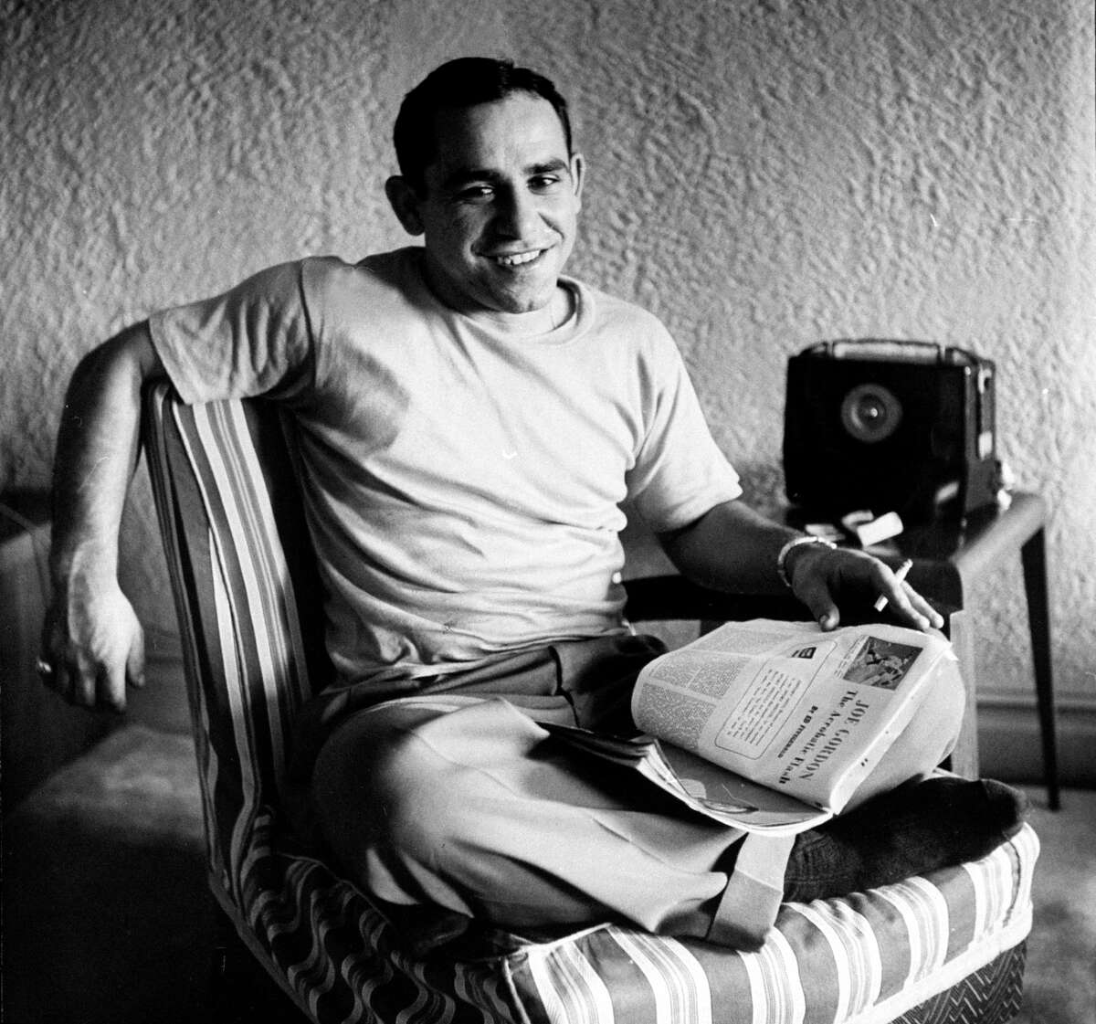 Baseball player Yogi Berra relaxing at home in the 1950s.