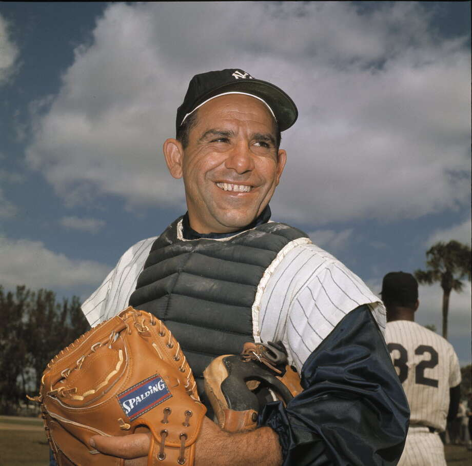 File-New York Yankee catcher Yogi Berra poses at spring training in Florida, in an undated file photo. Berra, the Yankees Hall of Fame catcher has died. He was 90. (AP Photo/File)