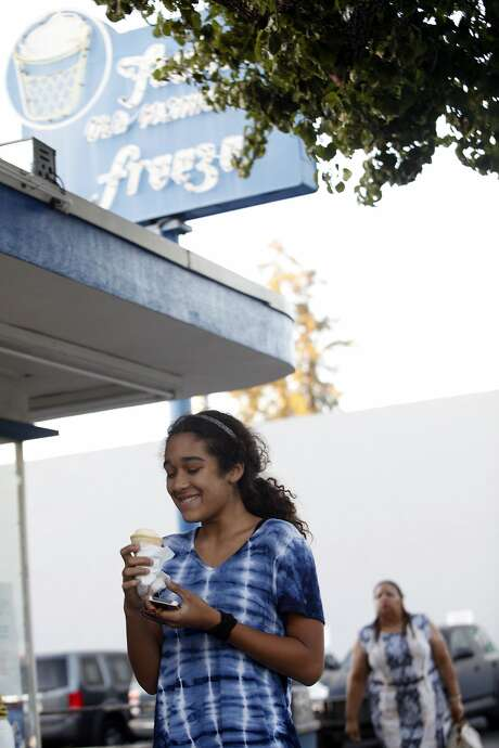 Claire Melnick, 12, of Menlo Park eats her ice cream from Foster's Freeze in Menlo Park. Photo: Franchon Smith, The Chronicle
