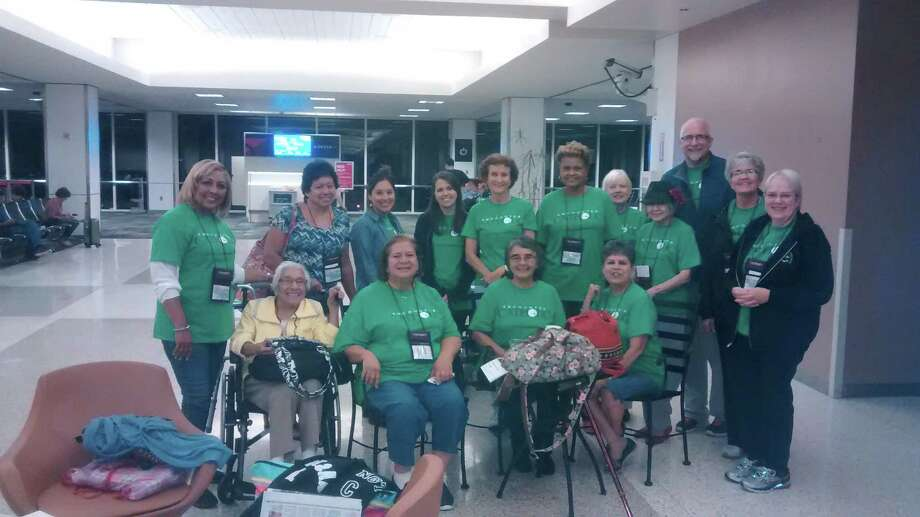 "Jerome Cabeen, back row, right, and the Diocese of Beaumont ""pilgrims"" to the Pope Francis visit in Philadelphia, prepare to board an early-morning flight from Houston.
