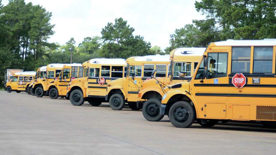 Conroe ISD school buses at the Conroe ISD bus barn,108 Gladstell in Conroe. Photograph by David Hopper.. Photo: David Hopper, Freelance / freelance
