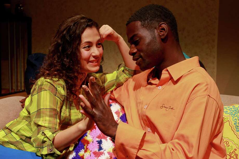 "Nina L. Garcia and Atseko Factor star in Ensemble Theatre's production of ""Plantanos y Collard Greens."" Photo: Gary Fountain, Freelance / Copyright 2015 by Gary Fountain"