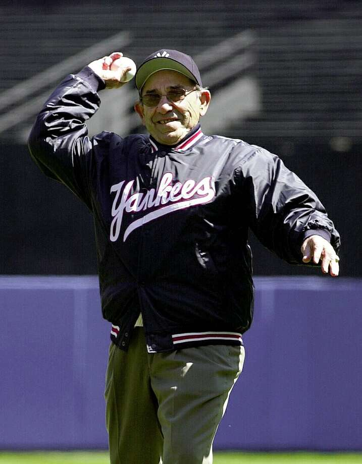 A picture taken on April 12, 2000 shows former New York Yankees catcher Yogi Berra throwing out the first pitch to start the home season for the New York Yankees in New York. Iconic New York Yankees catcher Yogi Berra, an athlete as beloved for his folksy sayings as for his legendary baseball career, has died at the age of 90, the Yogi Berra Museum said on September 23, 2015. Photo: Getty Images / AFP