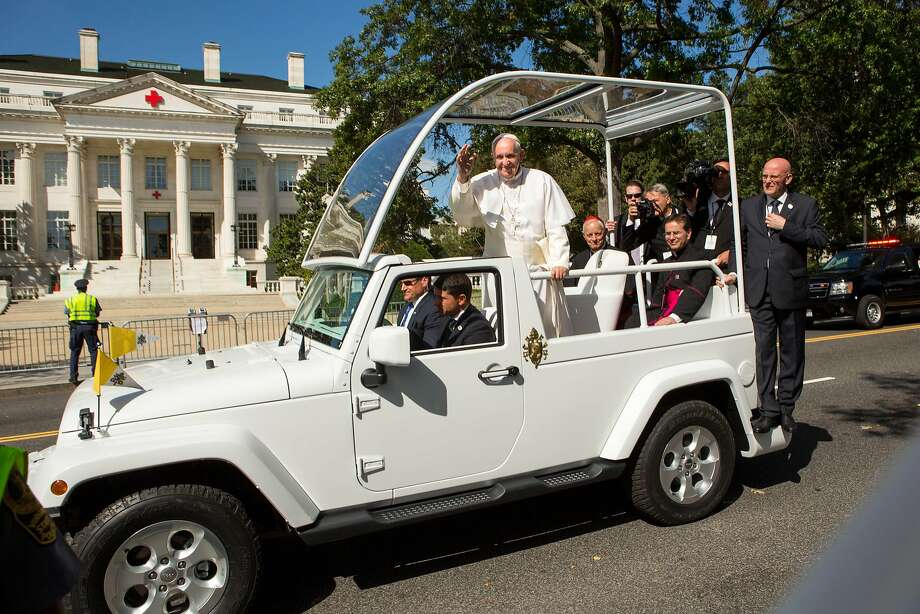 Pope Francis waves to the crowd as he rides in his Jeep Wrangler Popemobile along a parade route around the National Mall on September 23, 2015 in Washington, DC. Photo: Allison Shelley, Getty Images