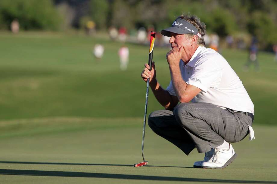 Michael Allen from San Mateo, Ca. checks his lie on 18th hole during the final round of the AT&T Championship, Champions Tour golf tournament at TPC San Antonio, AT&T Canyons Course on Sunday, Oct. 25, 2014. Allen won the tournament at 15 under.   MARVIN PFEIFFER/ mpfeiffer@express-news.net Photo: MARVIN PFEIFFER, STAFF / Marvin Pfeiffer/ Express-News / Express-News 2014