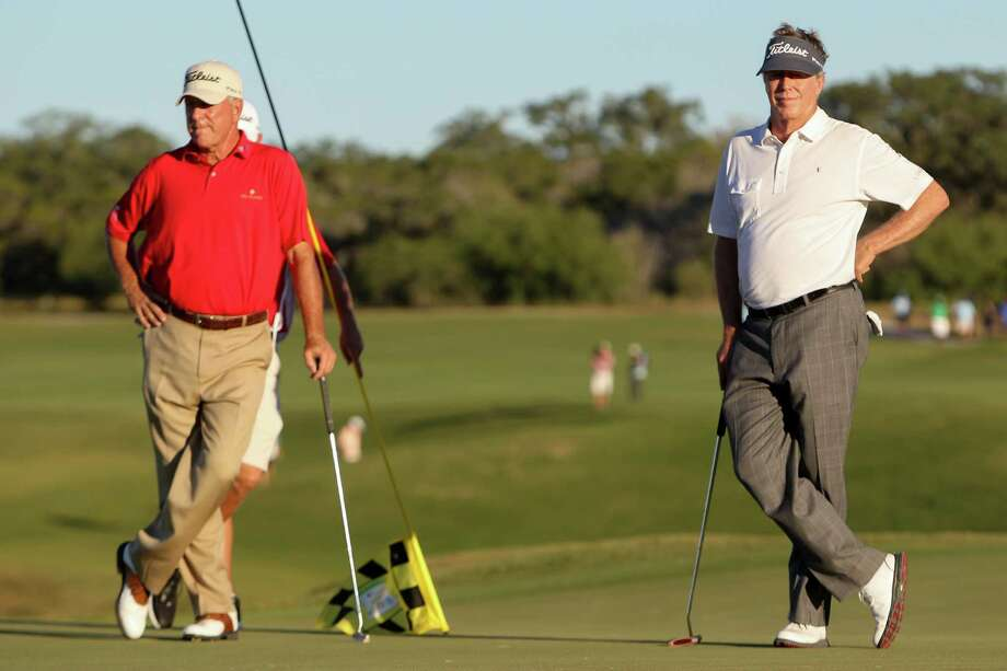 Michael Allen from San Mateo, CA. (right) and Jay Haas from Greenville, S.C. wait their turn to put on the 18th hole of the final round of the AT&T Championship, Champions Tour golf tournament at TPC San Antonio, AT&T Canyons Course on Sunday, Oct. 25, 2014. Allen finished first, 15 shots under, while Hass finished tied for sixth, 10 shots under. Photo: Marvin Pfeiffer /San Antonio Express-News / Express-News 2014