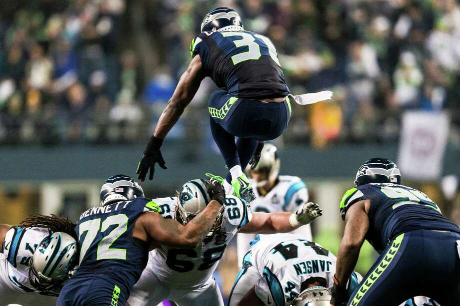 Kam Chancellor, top, leaps over his team's defensive line in an attempt to block a Panthers field goal during the first half of a NFC Divisional Playoffs game Saturday, January 10, 2015, at CenturyLink Field in Seattle, Washington. Photo: JORDAN STEAD, Seattlepi.com / SEATTLEPI.COM