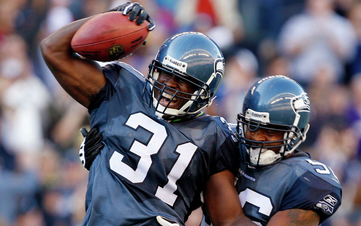 Seattle Seahawks' Kam Chancellor (31) celebrates with Leroy Hill after intercepting against the Arizona Cardinals in the second half of an NFL football game, Sunday, Sept. 25, 2011, in Seattle. The Seahawks won 13-10.