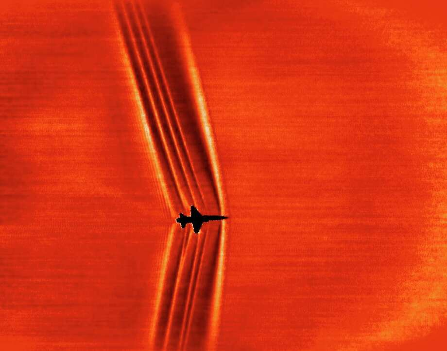 NASA caption: This schlieren image of a T-38C was captured using the patent-pending BOSCO technique and then processed with NASA-developed code to reveal shock wave structures.