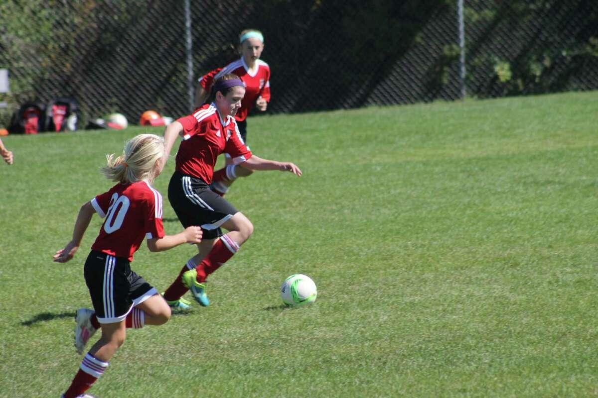 Elizabeth St. George dribbles through the Bethel defense.