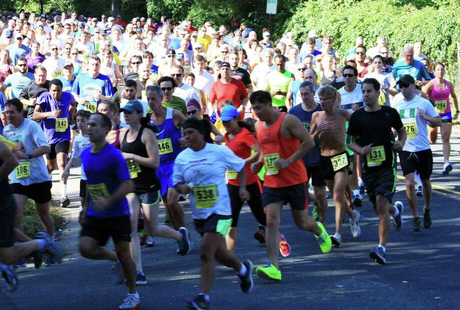 Hundreds of runners hit the 5K course in a recent Bigelow Tea Community Challenge, set this year for Sept. 27. Photo: Contributed Photo / Fairfield Citizen