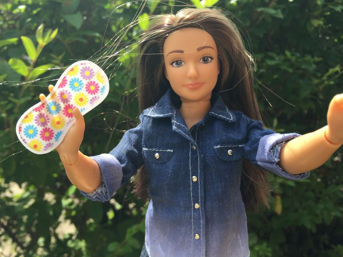 """Lammily's Period Party accessories for dolls include 18 mini colored pads, a pair of underwear, an educational pamphlet and a calendar with stickers for tracking the """"doll's cycle."""""""