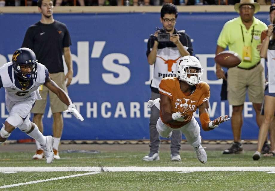 Texas receiver John Burt (1) catches a pass against California defensive back Darius White during the first half of an NCAA college football game, Saturday, Sept. 19, 2015, in Austin, Texas. (AP Photo/Michael Thomas) Photo: Michael Thomas, Associated Press
