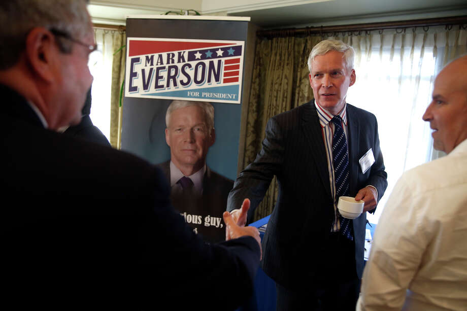Presidential candidate and former IRS Commissioner Mark Everson greets people during the Silicon Valley GOP Forum in Menlo Park. Below, candidate Ben Carson appears at the event via Skype. Photo: Scott Strazzante / Photos By Scott Strazzante / The Chronicle / ONLINE_YES