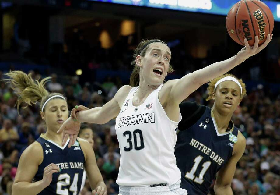 Connecticut forward Breanna Stewart (30) recovers a rebound as Notre Dame guard Hannah Huffman (24) and Notre Dame forward Brianna Turner (11) look on during the second half of the NCAA women's Final Four tournament college basketball championship game, Tuesday, April 7, 2015, in Tampa, Fla. Photo: Brynn Anderson /Associated Press / AP