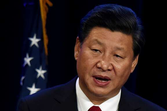 Chinese President Xi Jinping speaks during his welcoming banquet at the start of his visit to the United States, at the Westin Hotel in Seattle, Washington on September 22, 2015.  President Xi will makes a high-profile state visit to the White House this week, but he stops first in Washington state on the west coast to shore up support among skittish allies, especially big business. The Seattle talks will be heavily focused on business, trade and economics.          AFP PHOTO/MARK RALSTONMARK RALSTON/AFP/Getty Images