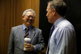 San Francisco Mayor Ed Lee (left) speaks with editorial page editor John Diaz (right) after an interview at the Chronicle's offices in San Francisco, California, on Wednesday, Sept. 23, 2015.