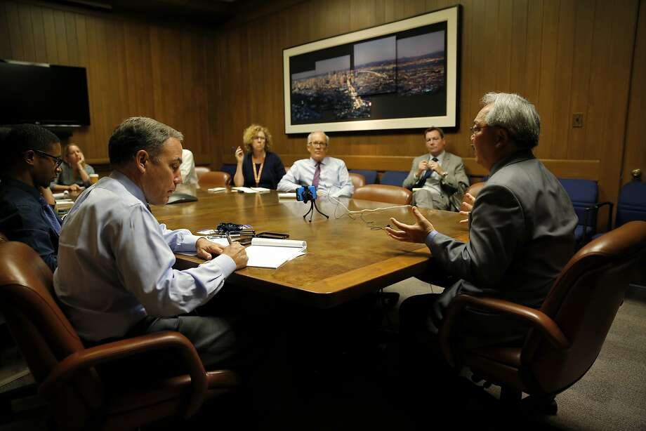 San Francisco Mayor Ed Lee (right) speaks with the San Francisco Chronicle editorial board at the Chronicle's offices in San Francisco, California, on Wednesday, Sept. 23, 2015. Photo: Connor Radnovich, The Chronicle