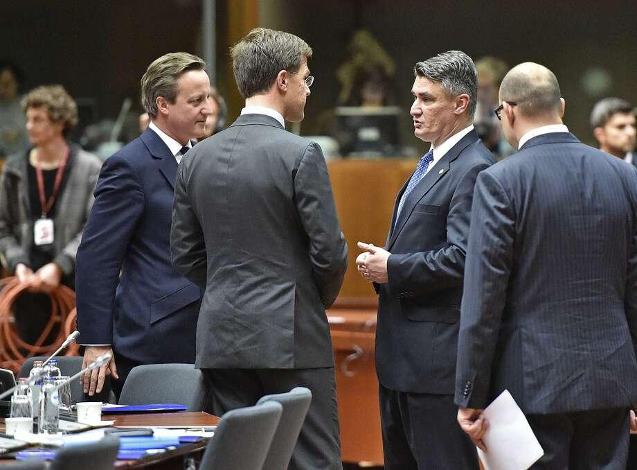 British Prime Minister David Cameron (left), his Dutch counterpart, Mark Rutte (center), and Croatian premier Zoran Milanovic discuss the crisis. Photo: Martin Meissner, Associated Press