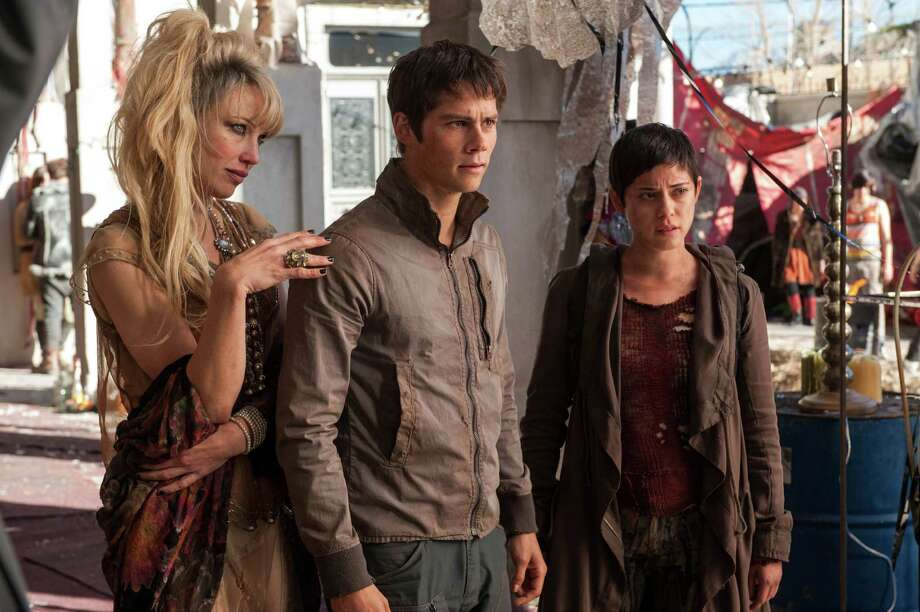 "In this image released by 20th Century Fox, Jenny Gabrielle, from left, Dylan O'Brien and Rosa Salazar appear in a scene from the film, ""Maze Runner: The Scorch Trials."" (Richard Foreman, Jr./20th Century Fox via AP)   ORG XMIT: CAET325 Photo: Richard Foreman, Jr. / 20th Century Fox"