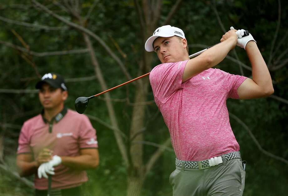 LAKE FOREST, IL - SEPTEMBER 18:  Jordan Spieth plays his shot from the seventh tee as Jason Day of Australia looks on during the Second Round of the BMW Championship at Conway Farms Golf Club on September 18, 2015 in Lake Forest, Illinois.  (Photo by Patrick Smith/Getty Images) Photo: Patrick Smith, Getty Images