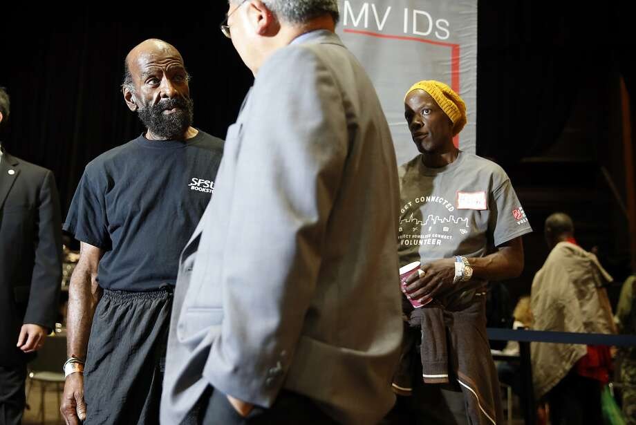 San Francisco Mayor Ed Lee speaks with a homeless man, who refused to be identified, and Harry Lloyd (right) at Project Homeless Connect at Bill Graham Civic Auditorium in San Francisco, Calif., on Wednesday, September 23, 2015. Photo: Scott Strazzante, The Chronicle