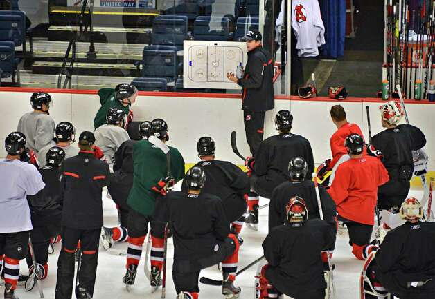 Albany Devils' head coach Rick Kowalsky, center, with players during practice at the Times Union Center Thursday Oct. 3, 2013, in Albany, NY.(John Carl D'Annibale / Times Union) Photo: John Carl D'Annibale / 00024096A